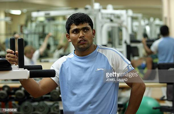 Pakistani cricketer Kamran Akmal takes a break as he exercises in a gym of the hotel in PortofSpain 03 March 2007 ahead of their warmup matches of...
