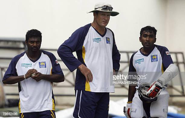 Sri Lanka Cricket captain Mahela Jayawardene talks with Coach Tom Moody as Muttiah Muralitharan waits for his turn to bowl during the training...