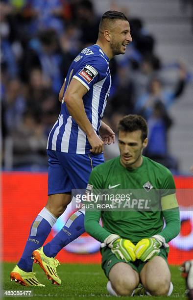Porto's Algerian forward Nabil Ghilas celebrates after scoring past Academica's goalkeeper Ricardo Nunes during the Portuguese league football match...