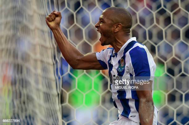 Porto's Algerian forward Yacine Brahimi celebrates after scoring a goal during the Portuguese league football match FC Porto vs Belenenses at the...