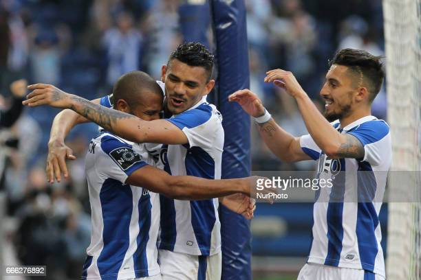 Porto's Algerian forward Yacine Brahimi celebrates after scoring goal with teammates during the Premier League 2016/17 match between FC Porto and...