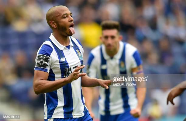 Porto's Algerian forward Yacine Brahimi celebrates after scoring on a penalty kick during the Portuguese league football match FC Porto vs FC Pacos...