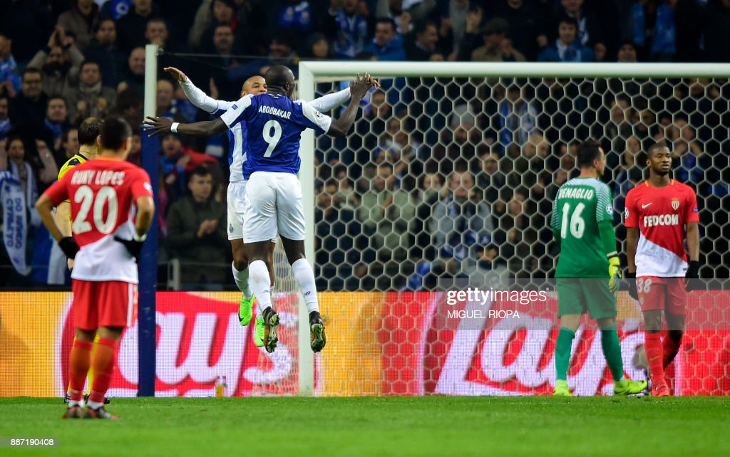 Porto's Algerian forward Yacine Brahimi (jumping L) celebrates with teammate Porto's Cameroonian forward Vincent Aboubakar after scoring a goal during their UEFA Champions League group G football match FC Porto vs Monaco at the Dragao stadium in Porto, on December 6, 2017. Porto won the match 5-2. /