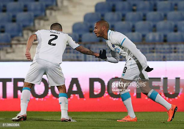 Porto's Algerian forward Yacine Brahimi celebrates with teammates after scoring a goal during the Primeira Liga match between Os Belenenses and FC...