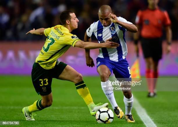 Porto's Algerian forward Yacine Brahimi challenges Pacos de Ferreira's defender Francisco Afonso during the Portuguese league football match FC Porto...