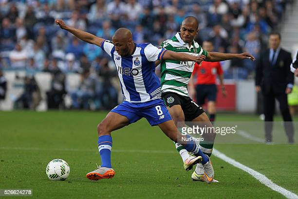 Porto's Algerian forward Yacine Brahimi in action with Sporting's Portuguese midfielder Jo��o M��rio during the Premier League 2015/16 match between...