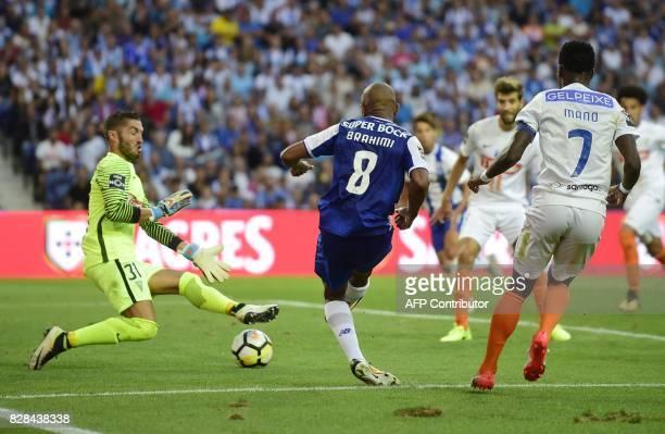 Porto's Algerian forward Yacine Brahimi shoots against Estoril's goalkeeper Moreira during the Portuguese league football match FC Porto vs Estoril...