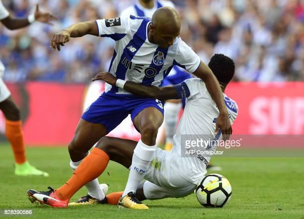 Porto's Algerian forward Yacine Brahimi vies with Estoril's defender Mano during the Portuguese league football match FC Porto vs Estoril Praia at...
