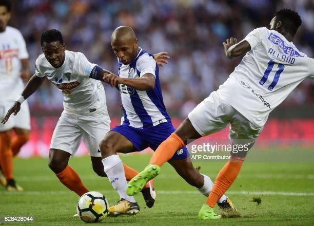 Porto's Algerian forward Yacine Brahimi vies with Estoril's defender Mano and Brazilian forward Allano during the Portuguese league football match FC...