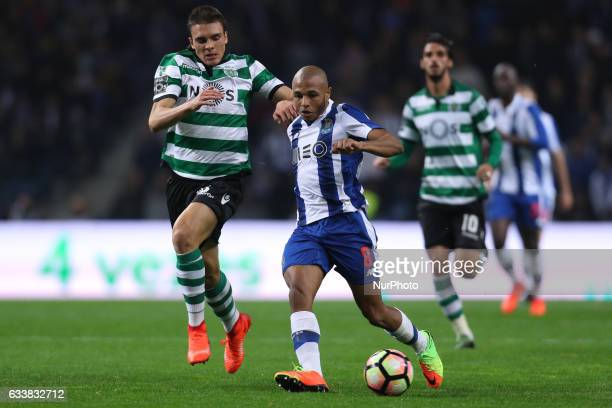 Porto's Algerian forward Yacine Brahimi vies with Sporting's Portuguese midfielder Joao Palhinha during the Premier League 2016/17 match between FC...