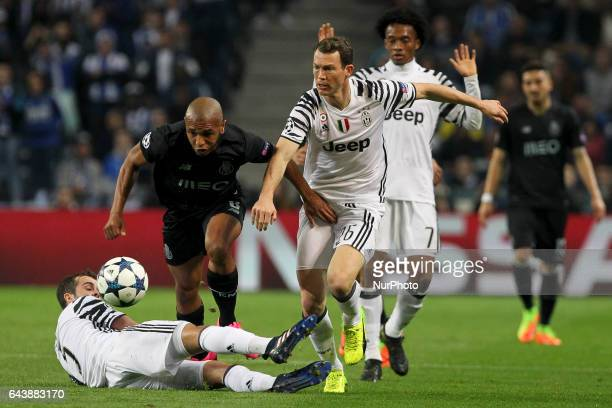 Porto's Algerian forward Yacine Brahimi with Stephan Lichtsteiner defender of Juventus FC during the UEFA Champions League Round of 16 1st leg soccer...