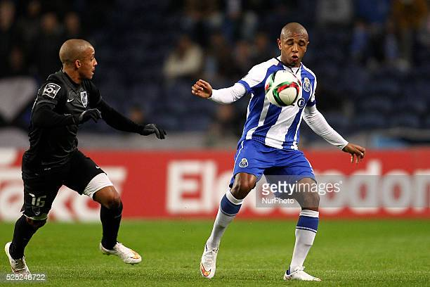 Porto's Algerian midfielder Yacine Brahimi in action with Vitoria SC's Portuguese defender Bruno Gaspar during the Premier League 2014/15 match...