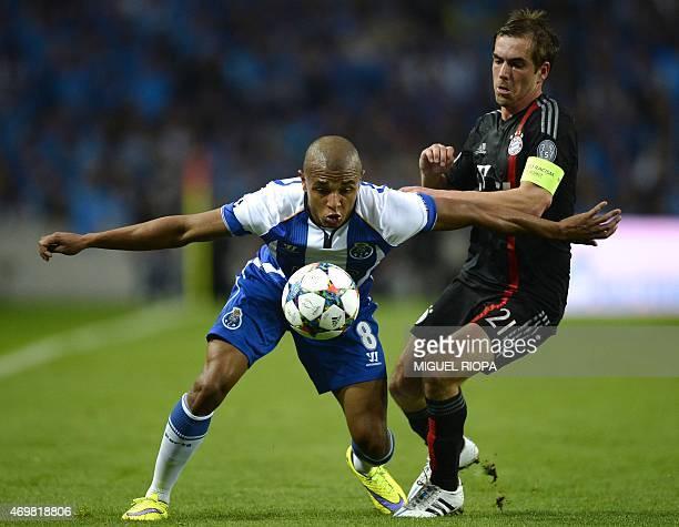 Porto's Algerian midfielder Yacine Brahimi vies with Bayern Munich's defender Philipp Lahm during the UEFA Champions League quarter final football...