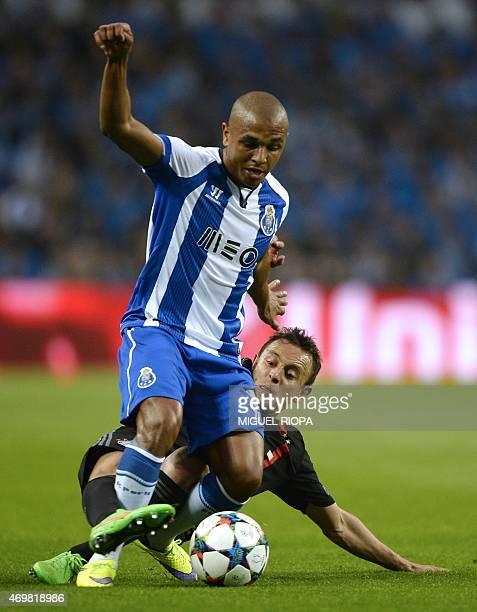 Porto's Algerian midfielder Yacine Brahimi vies with Bayern Munich's Brazilian defender Rafinha during the UEFA Champions League quarter final...