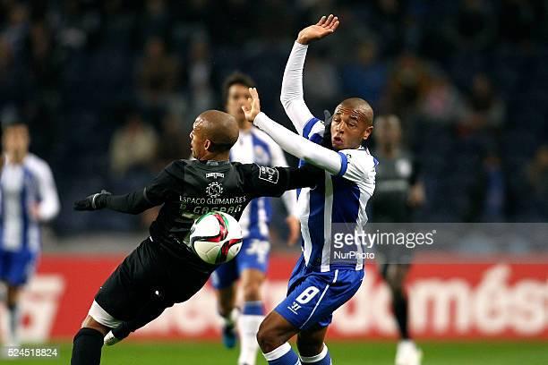 Porto's Algerian midfielder Yacine Brahimi vies with Vitoria SC's Portuguese defender Bruno Gaspar during the Premier League 2014/15 match between FC...