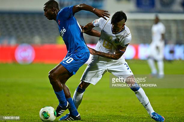 FC Porto's Argentine midfielder Lucho Gonzalez vies with Belenenses' Malian midfielder Mourtala Diakite during the Portuguese league football match...
