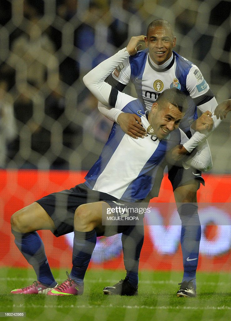 Porto's Argentinian defender Nicolas Otamendi (front) and his teammate Brazilian midfielder Fernando celebrate their team's second score during the Portuguese league football match FC Porto vs Gil Vicente at the Dragao Stadium in Porto on January 28, 2013.