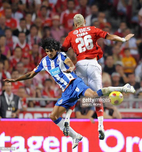 FC Porto's Argentinian Lucho Gonzalez vies with SL Benfica's french Hassan Yebda during their Portuguese First league football match at the Luz...