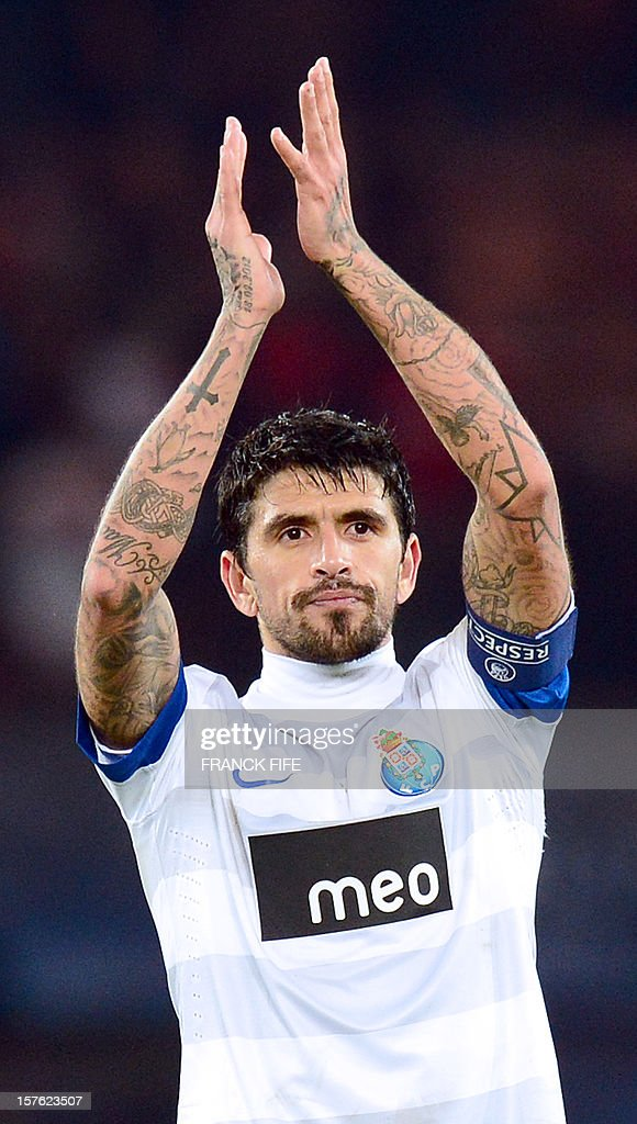 Porto's Argentinian midfielder Lucho Gonzalez reacts at the end of the UEFA Champions League Group A football match Paris Saint-Germain vs Porto on December 4, 2012 at the Parc des Princes stadium in Paris. Paris won 2-1.