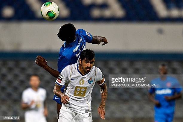 FC Porto's Argentinian midfielder Lucho Gonzalez vies with Belenenses' Malian midfielder Mourtala Diakite during the Portuguese league football match...