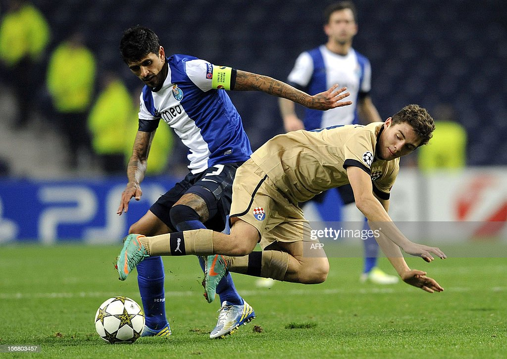 FC Porto's Argentinian midfielder Lucho Gonzalez (L) vies with GNK Dinamo Zagreb's Croacian midfielder Marcelo Brozovic during the UEFA Champions League group A football match FC Porto against GNK Dinamo Zagreb on November 21, 2012, at Dragao Stadium in Porto.