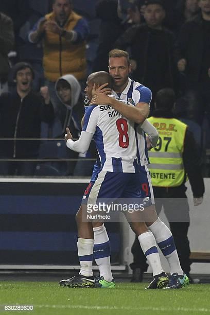 Porto's Belgian forward Laurent Depoitre celebrates after scoring goal with teammate Porto's Algerian forward Yacine Brahimi during the Premier...