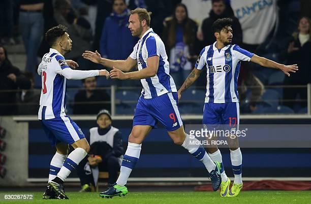 Porto's Belgian forward Laurent Depoitre celebrates with teammates Brazilian defender Alex Telles and Mexican forward Jesus Corona after scoring...