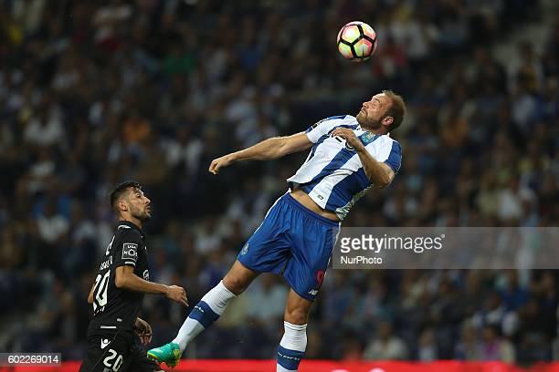 Porto's Belgian forward Laurent Depoitre in action with Vitoria SC's Portuguese defender Joao Aurelio during the Premier League 2016/17 match between...