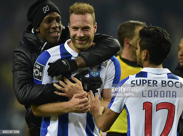 Porto's Belgian forward Laurent Depoitre is congratulated by teammates French defender Willy Boly at the end of the Portuguese league football match...