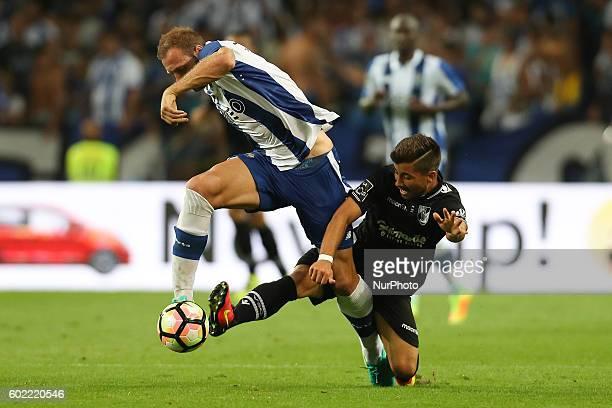Porto's Belgian forward Laurent Depoitre vies with Vitoria SC's Portuguese midfielder Toze during the Premier League 2016/17 match between FC Porto...