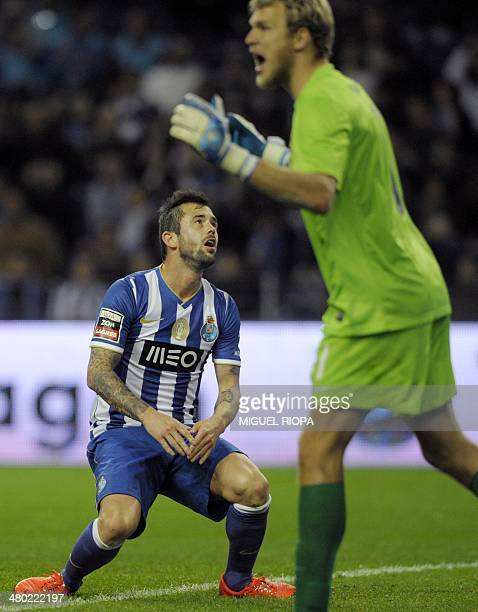 Porto's Belgian midfielder Steven Defour reacts after missing an opportunity to score during the Portuguese league football match FC Porto v CF Os...