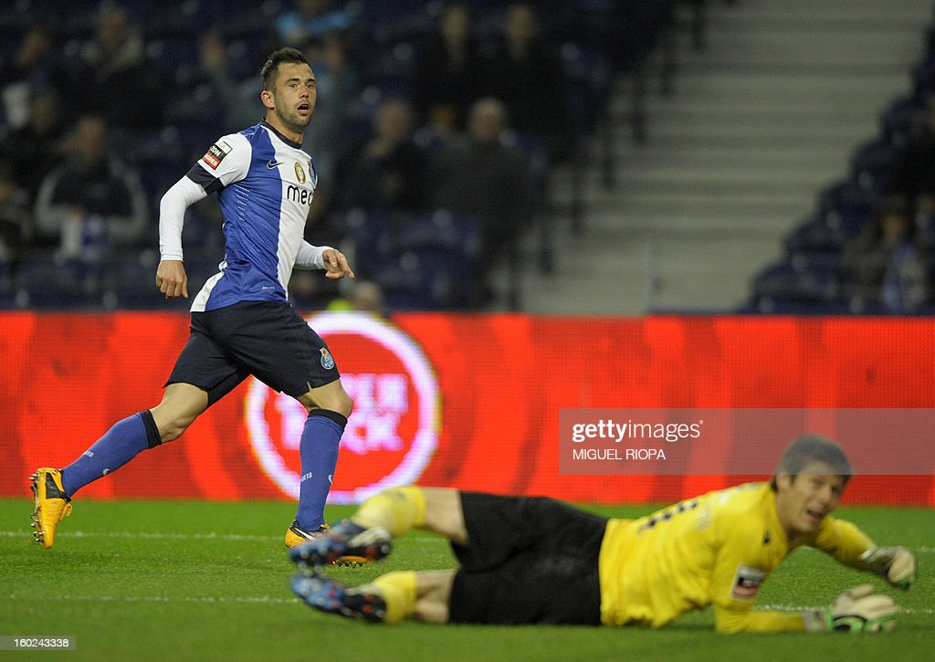 Porto's Belgian midfielder Steven Defour (L) reacts after scoring during the Portuguese league football match FC Porto vs Gil Vicente at the Dragao Stadium in Porto on January 28, 2013.