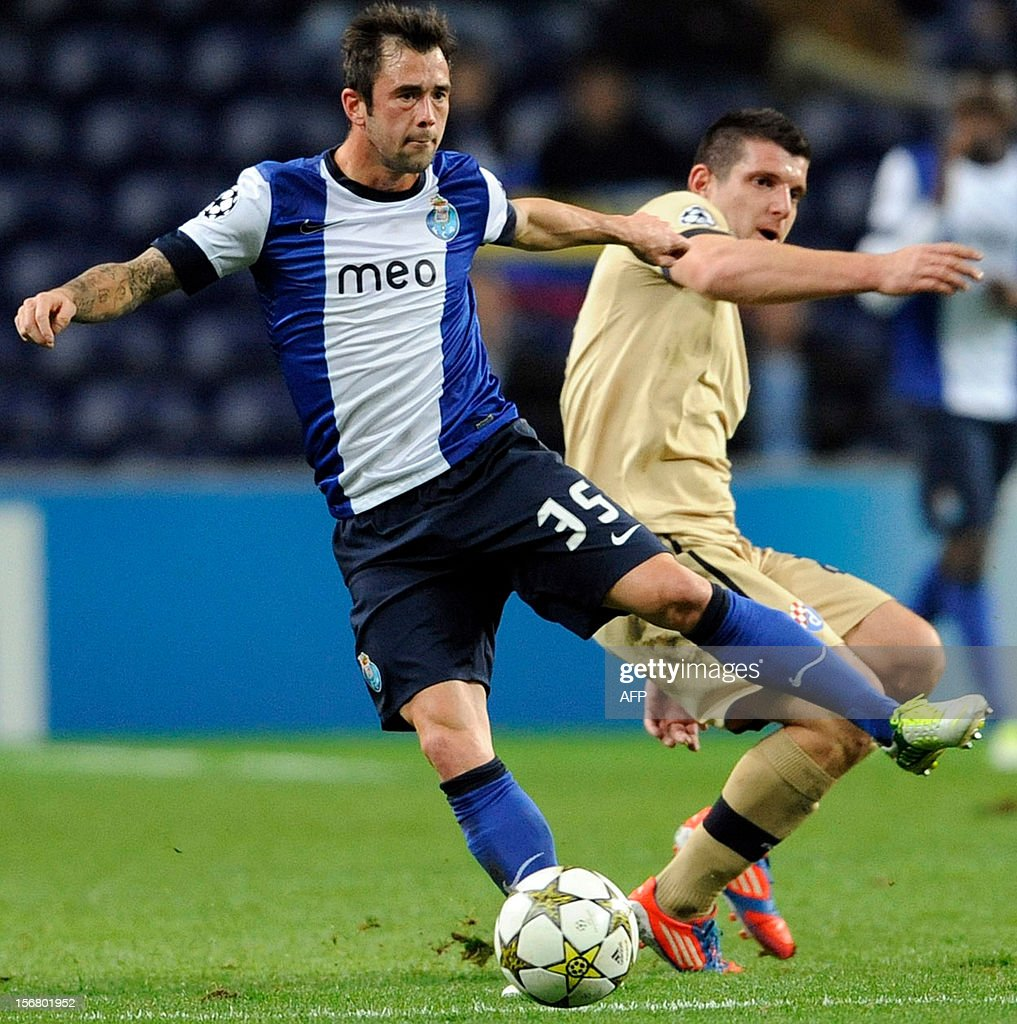 FC Porto's Belgian midfielder Steven Defour (R) vies with GNK Dinamo Zagreb's Montenegrin forward Fatos Becira during the UEFA Champions League group A football match FC Porto against GNK Dinamo Zagreb on November 21, 2012, at Dragao Stadium in Porto.