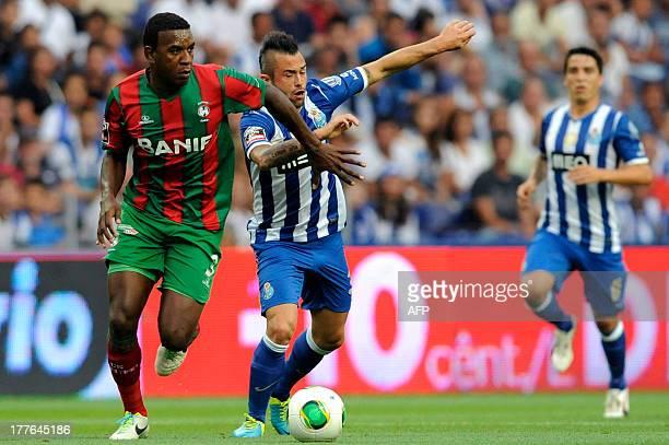 FC Porto's Belgian midfielder Steven Defour vies with Maritimo's Brazilian defender Marcio Rozario during the Portuguese League football match FC...