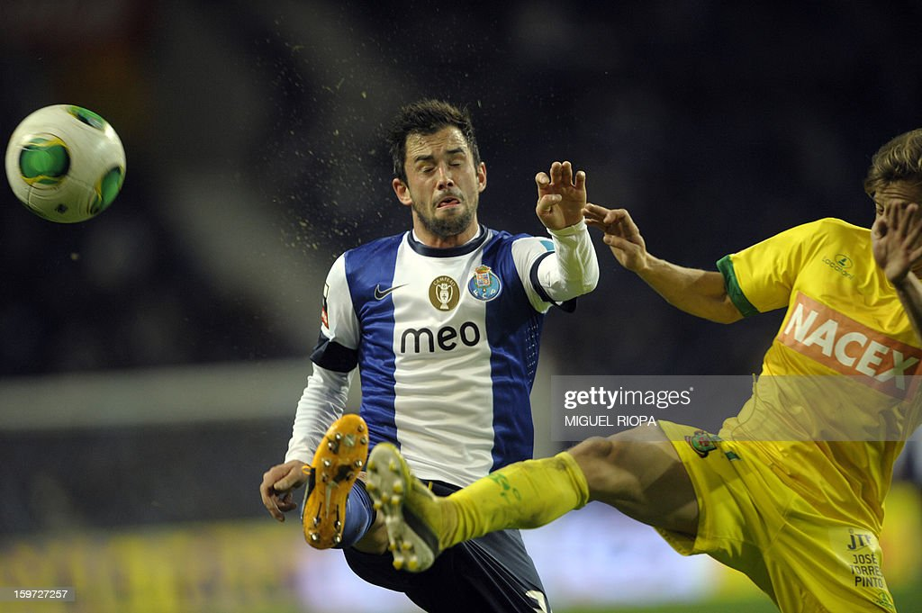 Porto's Belgian midfielder Steven Defour (L) vies with Pacos Ferreira's forward Rui Caetano during the Portuguese league football match FC Porto vs Pacos Ferreira at the Dragao stadium in Porto on January 19, 2013.