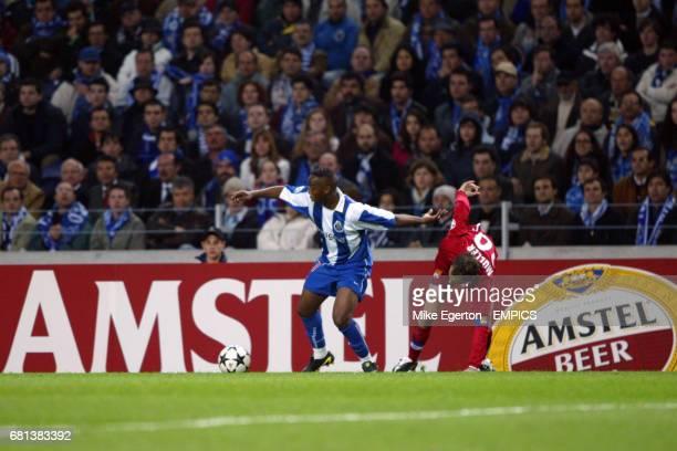 FC Porto's Benni McCarthy and Olympique Lyonnais' Patrick Muller battle for the ball