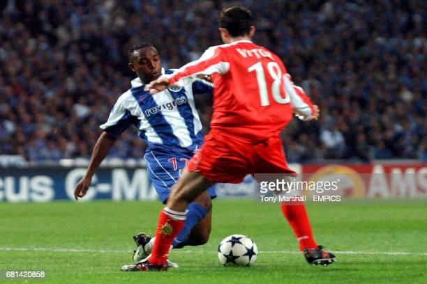 FC Porto's Benni McCarthy is tackled by Deportivo La Coruna's Victor