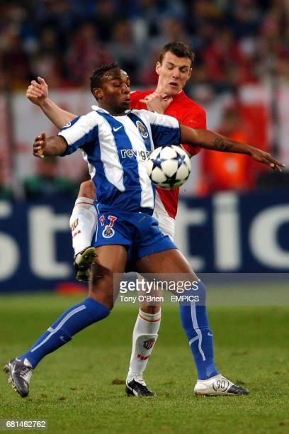 FC Porto's Benni McCarthy shields the ball from Monaco's Sebastien Squillaci