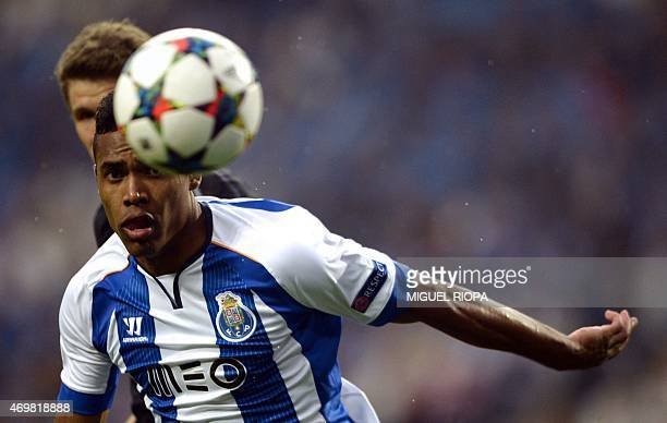 Porto's Brazilian defender Alex Sandro looks at the ball during the UEFA Champions League quarter final football match FC Porto vs FC Bayern Munich...