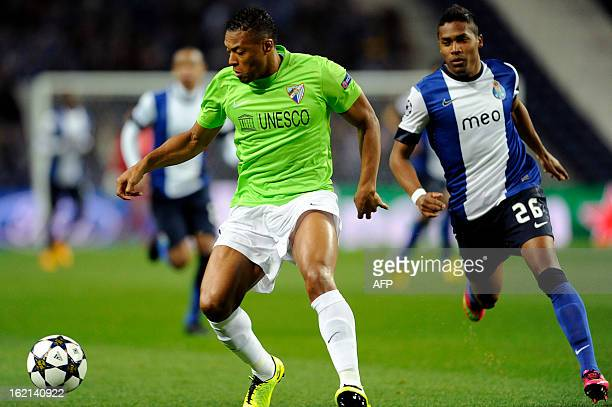 Porto's Brazilian defender Alex Sandro vies with Malaga's Brazilian midfielder Julio Baptista during the UEFA Champions League round of 16 first leg...