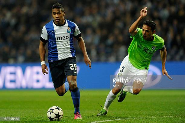 Porto's Brazilian defender Alex Sandro vies with Malaga's Brazilian defender Weligton during the UEFA Champions League round of 16 first leg football...