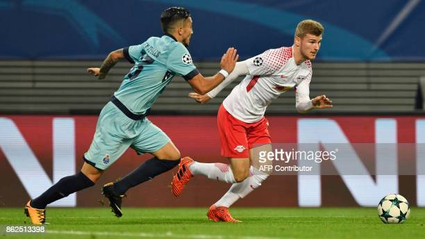 Porto's Brazilian defender Alex Telles and Leipzig's German forward Timo Werner vie for the ball during the UEFA Champions League group G football...