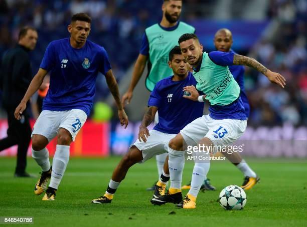 Porto's Brazilian defender Alex Telles Porto's Mexican forward Jesus Corona and Porto's Brazilian forward Soares warm up before the UEFA Champions...