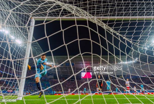 Porto´s Brazilian defender Alex Telles reacts after Leipzig´s French forward JeanKevin Augustin scored during the Champions League group G match...