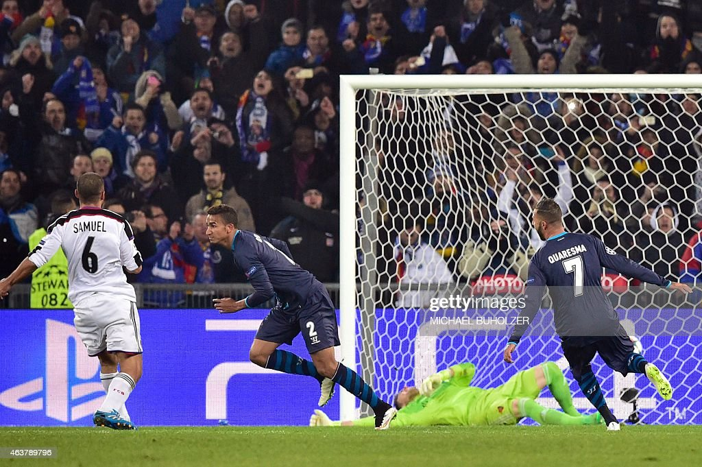 Porto's Brazilian defender Danilo (2ndL) reacts after scoring a penalty kick past Basel's Czech goalkeeper <a gi-track='captionPersonalityLinkClicked' href=/galleries/search?phrase=Tomas+Vaclik&family=editorial&specificpeople=5437912 ng-click='$event.stopPropagation()'>Tomas Vaclik</a> (Bottom) to equalize during the UEFA Champions League round of 16 first leg football match between Basel (FCB) and Porto (FCP) on February 18, 2015 at the St. Jakob-Park stadium in Basel.