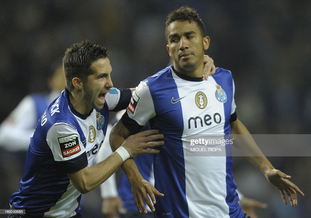 Porto's Brazilian defender Danilo Silva (R) celebrates with his teammate midfielder Joao Moutinho after scoring during the Portuguese league football match FC Porto vs Gil Vicente at the Dragao Stadium in Porto on January 28, 2013.