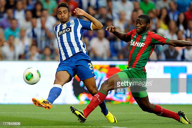 FC Porto's Brazilian defender Danilo Silva vies with Maritimo's BissauGuinean forward Sami during the Portuguese League football match FC Porto vs...