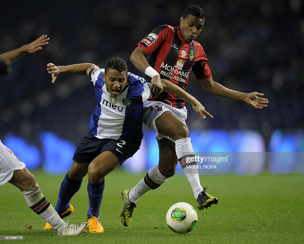 Porto's Brazilian defender Danilo Silva (L) vies with Olhanense's defender Vasco Fernandes during the Portuguese first league football match FC Porto vs Olhanense at the Dragao stadium in Porto, on February 10, 2013. The match ended in a draw 1-1. AFP PHOTO/ MIGUEL RIOPA