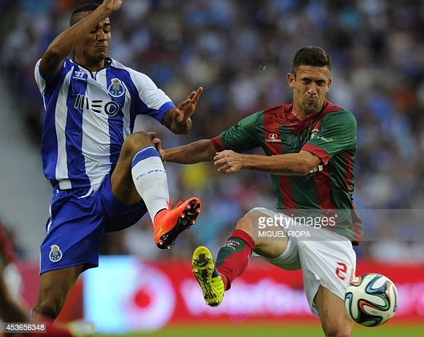 Porto's Brazilian defender Danilo vies with Maritimo's defender Joao Diogo during the Portuguese league football match FC Porto vs Maritimo at the...