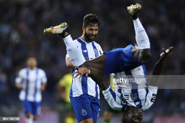 Porto's Brazilian defender Felipe celebrates after scoring goal with teammate Porto's Cameroonian forward Vincent Aboubakar during the Premier League...